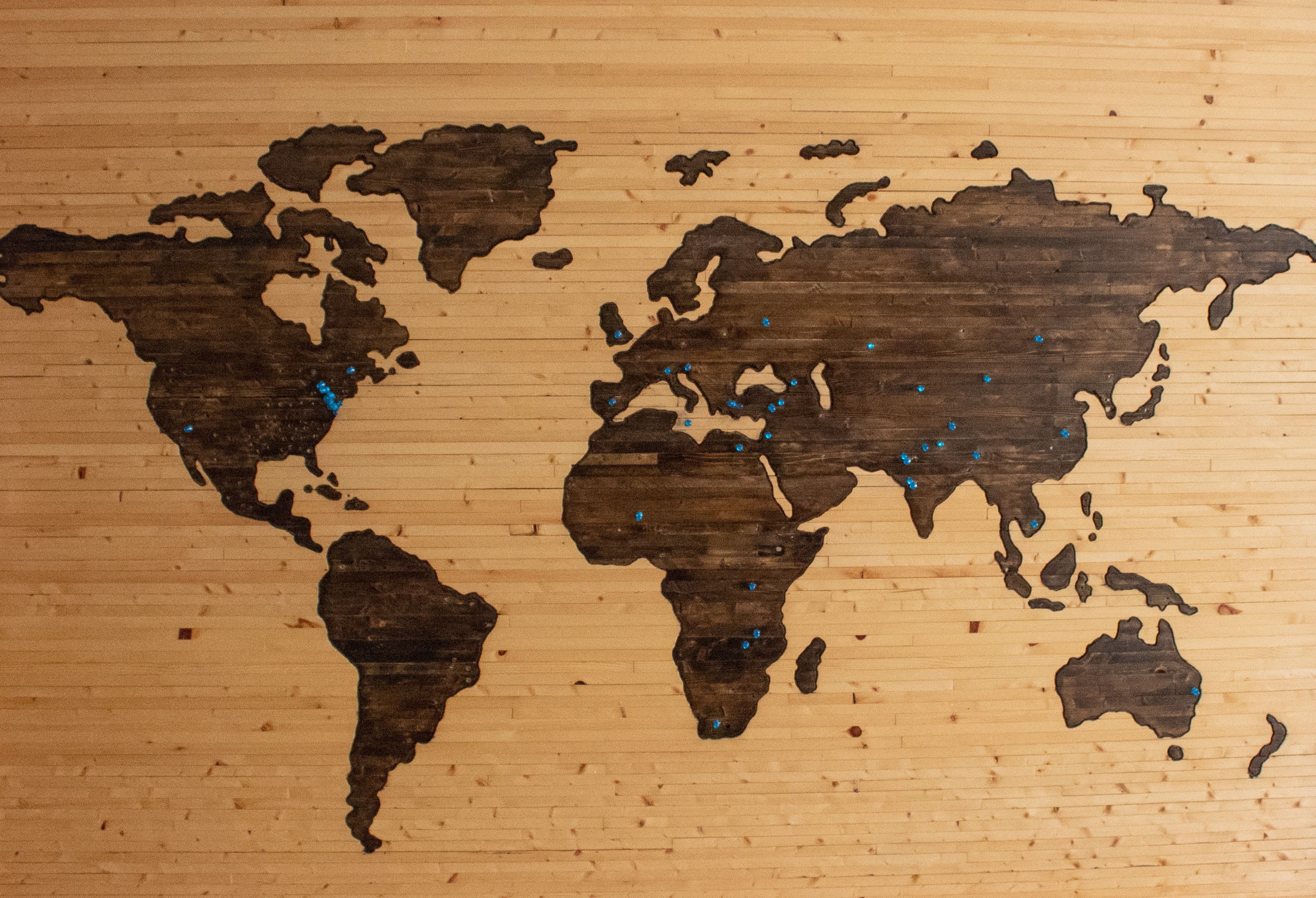 Wood burn world map with blue pins