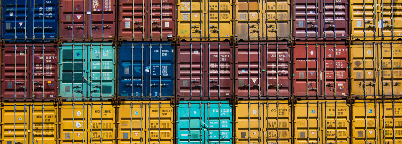Stacked rows of shipping containers