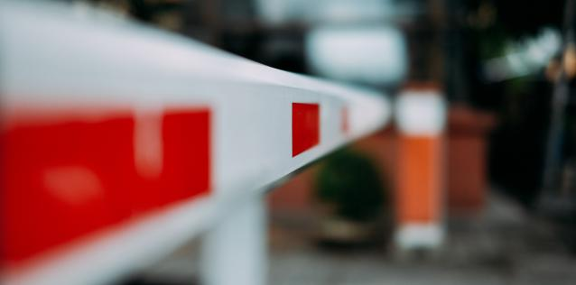 Red and white traffic barrier pole