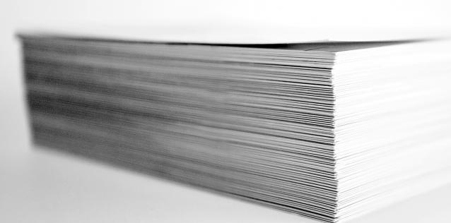 Stack of white paper on white backgrounnd