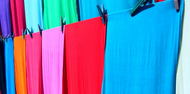 brightly colored cloth hanging on lines