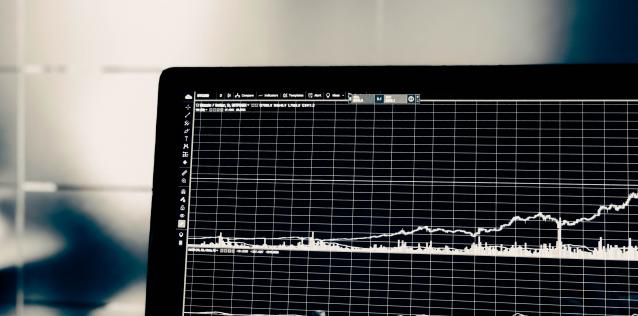 EC Card Laptop displaying data trend lines