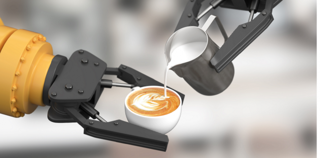 Robot pouring milk into latte